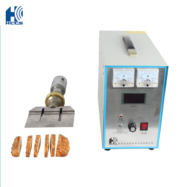 Hand held ultrasonic food cutting machine for frozen meat