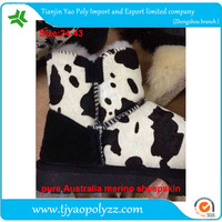 white and black cow grain snow boots horse hair upper and sheepskin liner