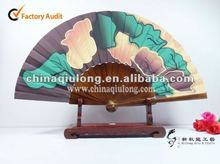 Colourful wooden hand fan