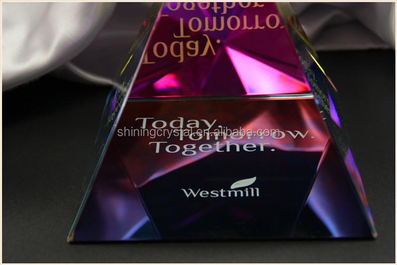 crystal glass pyramid paperweight with logo on the bottom