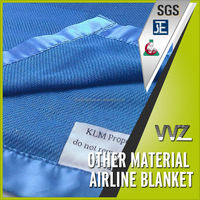 Polyester flame retardant airline blanket with stain binding Jacquard airline blanket with woven logo