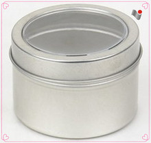 Small round empty tin box with PVC window lid