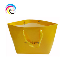 2018 customize lined high quality folded europe glossy golden colors wide bottom shopping paper bag with ribbon handle hotsales