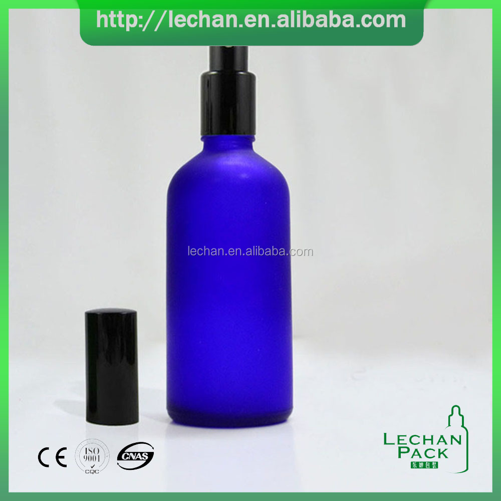 Packaging 60ml 2oz blue frosted essential oil glass bottle with gold silver black pump spray top