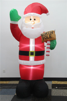 Standing christmas santa with light and hold a wooden hammer 2017