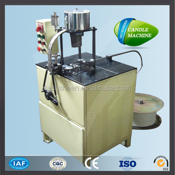 Automatic waxing candle wick cutting machine.