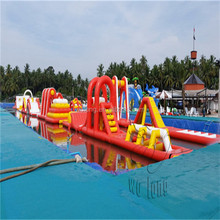 Giant inflatable floating water park with water pool slides