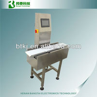 Online weight checking and sorting machine