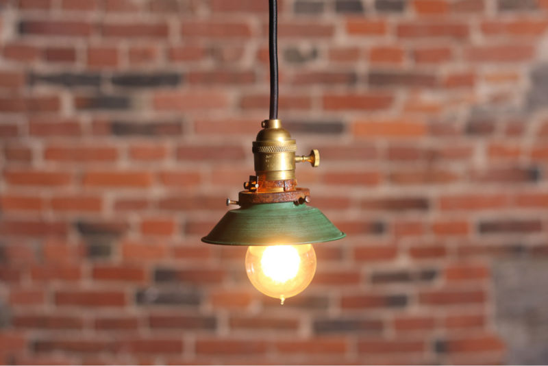 Industrial pendant lamp with small metal shade. Lamp is UL listed