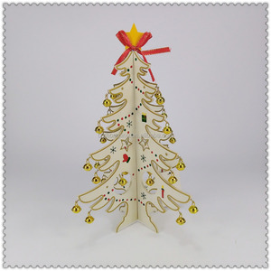 small wooden tree decorations hang small figures and bells Christmas decoration