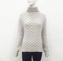 Dropped shoulder merino wool sweater for woman in fancy special construction