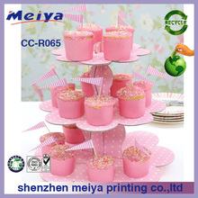 3 tier pink cardboard cake stands with small flags,flower-shaped paper cupcake stand