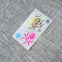 Water transfer temporary neon tattoo with spider design