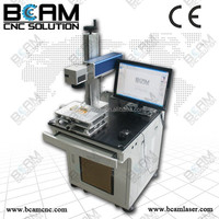 China laser marking and engraving machine for mobile phone cover/ear phone