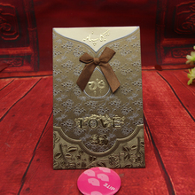 2017 Luxurious pocket design wedding invitation card wih unique gold embossed and Ribbon