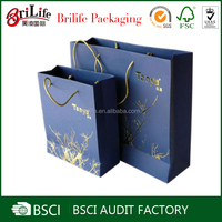 Luxury white kraft paper clothing packaging bag supplier