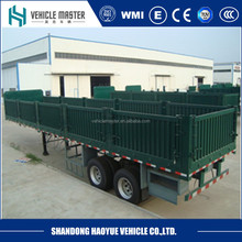 Haoyue factory new 3 axles 60 tons cargo trailer with 28ton landing gear