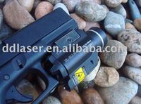 red handgun laser light and light illumination