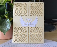 laser cut light gold pearl paper wedding invitation laser cut covers , love swan cards