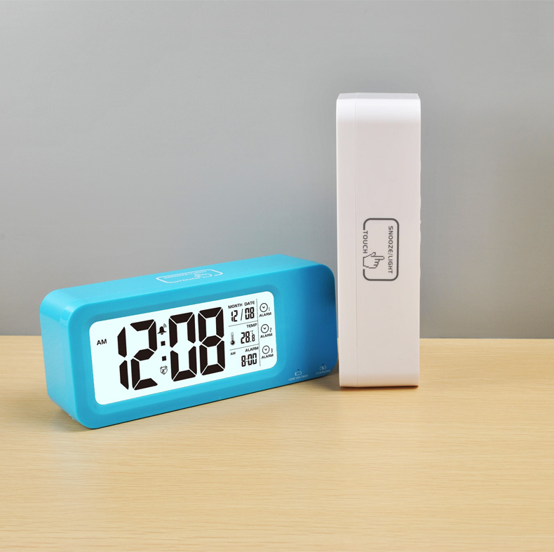Electronic LCD digital table alarm clock with weather station and temperature display