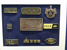 China manufacture firefighter custom embossed metal sticker and plating bronze or golden color