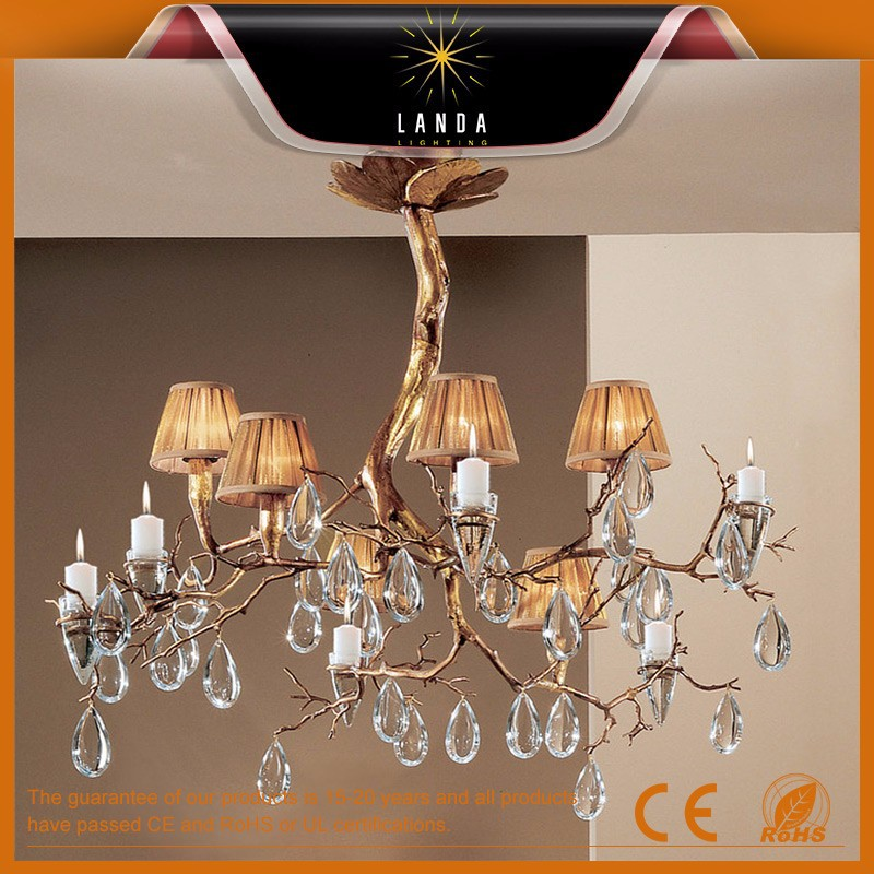 ancient plated golden iron wrought branched crystal chandeliers for soft sourrounding interior decoration
