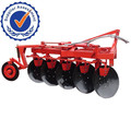 Farm Tractor driving reversible agricultural disc plough and disc plow