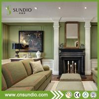 Inexpensive living room fireplace green wall panel wainscoting idea