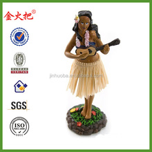 2014 promotional resin girl with Ukulele hula doll tan skirt.