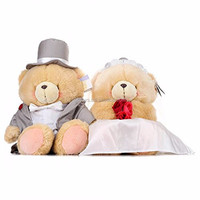 The plush teddy bear with wedding dress