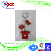 promotional red T-shirt shape key chain with pictures of football club logo and facial expression