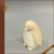 Ceramic angel figurine with sleeping bear
