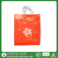 small printed plastic gift bag with handles