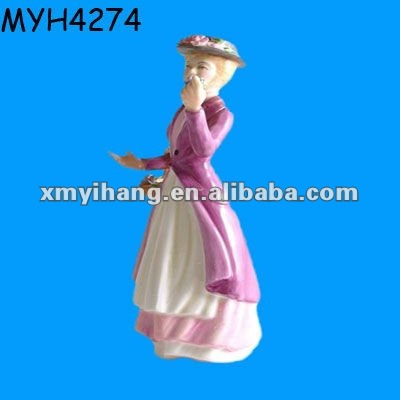 Pretty porcelain lady figurine in the style of Eliza from My Fair Lady