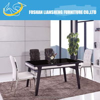 MDF and glass top dining table with solid wood leg