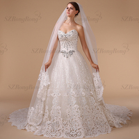 HM96081 gorgeous heavily crystal beaded appliqued and sequined strapless ball gown wedding dress with chapel train