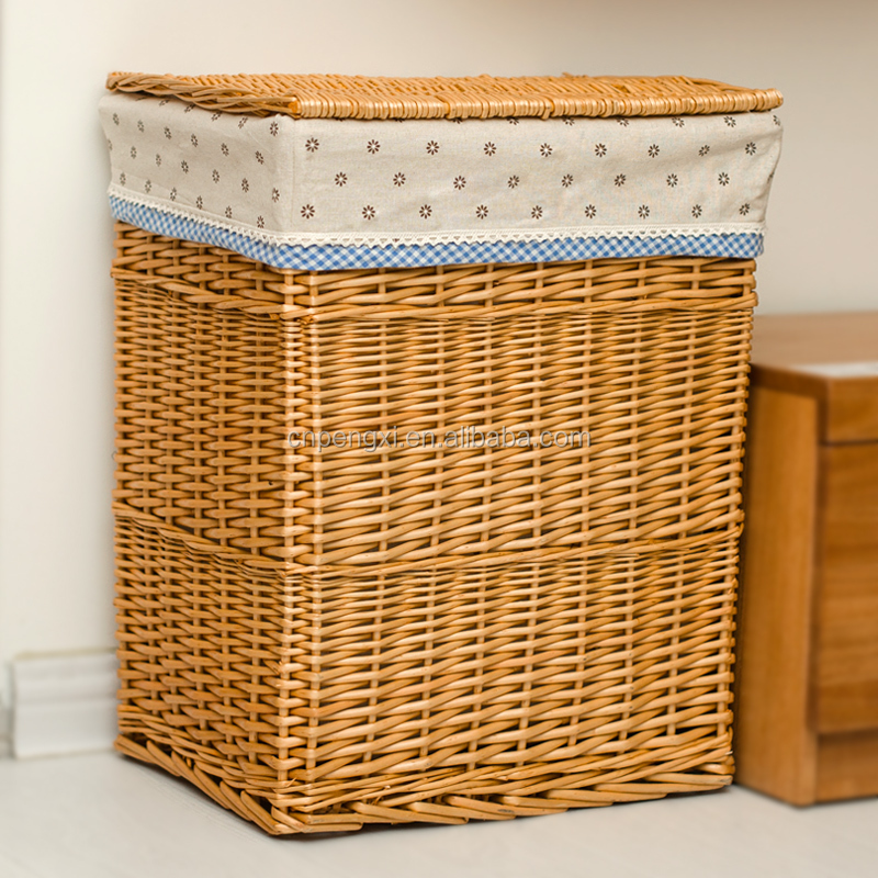 large rectangular black fabric lined wicker laundry basket with lid
