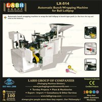 Automatic bunch wrapping machine for ball lollipop