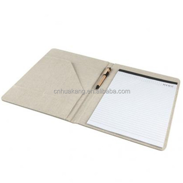 A4 portfolio in cotton/jute. Inside compartment with business card holder, paper barrel ball pen and 40 pages white lined paper
