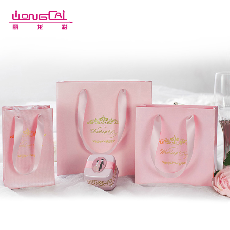 Customised high end luxury pink recyclable rope handle wedding door gift paper bag