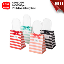 Chinese Custom Handmade With Logo Glossy Kids Mini Christmas Gift Paper Red Candy Packaging Bag