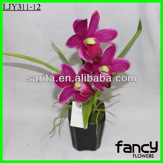 Artificial orchid flower in decorative pots