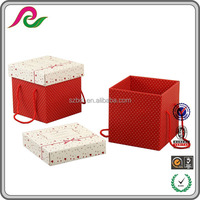 Stronger folding corrugated paper box with red handle for gift packaging