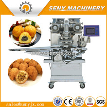 Filled cake encrusting making machine Meatball filling forming encrusting machine Maamoul kubba encrusting machine