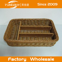 A sturdy and practical cutlery tray hand woven from rattan, with 4 compartments