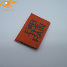 Top quality woven brand label with end fold and center fold