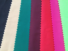 Knitting polyester spandex four way stretch swimwear fabric semi-dull spandex jersey fabric polyester elastic stretch fabric