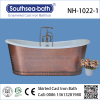 Stunning traditional master bathroom Freestanding Cast Iron Bathtub with copper skirt