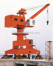Swing portal cranes with spreader or grab on the dock