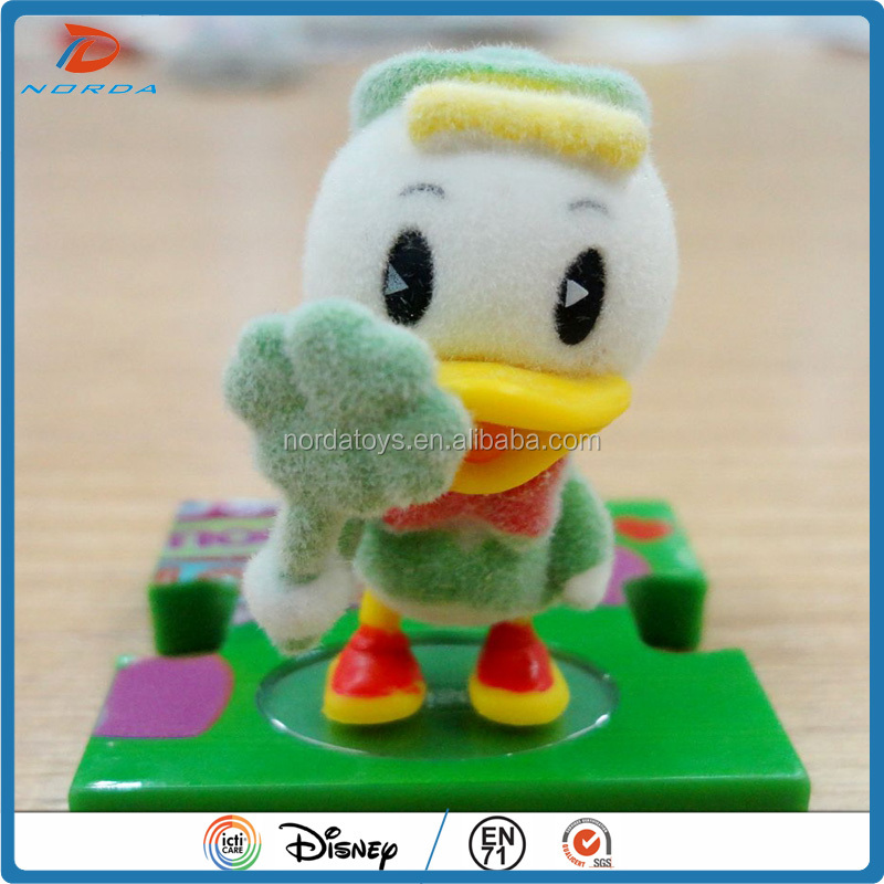 Custom made flocked plastic Duck shape figure toy